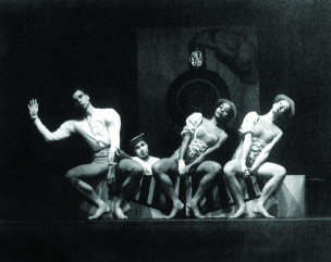 Black and White photo of mercy Cunningham and 3 dancers leaning away from each other