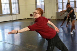 Holley Farmer demonstrating moves to dance students