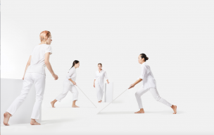 4 dancers carrying white panels in Brian Brooks's DIVISIONS