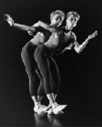 two dancers bent at the hip