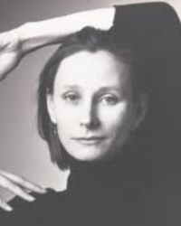 susan Marshall with her arm on her head