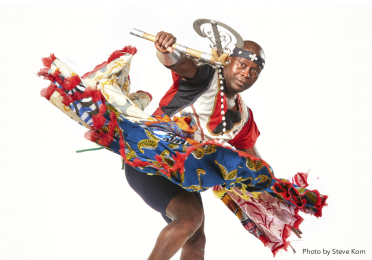 Flyer for Free Masterclass: West African Dance with Live Drumming, picturing Etienne Cakpo in traditional Benin dance clothing, and listing information about the class.