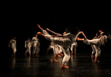 dancers in orange socks arabesque in motion