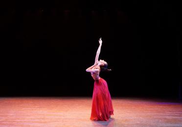 Emily Chen reaching towards upwards