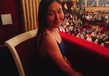 Emily Koya sitting at the opera