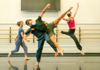 Dances leaping and tumbling over and around each other in the studio