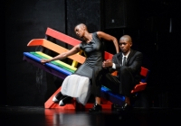 two dancers sit on a slanted bench