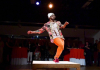 Michael O'Neal dances on a small square stage