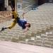 Roel Seeber hangs sideways from the ceiling in a harness.